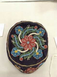 Boozhoo!  Beautiful set of photos of Anishinaabe beadwork -- this hat to me seems to show an exchange of beauty with the Haudenosaunee (Iroquois) Confederacy and the Metis!  Walking Through The Life Of Beads