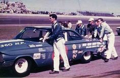 The B. G. Holloway crew push Johnny Allen's car to the line for the 1961 Daytona 500 - Allen finished 8th...