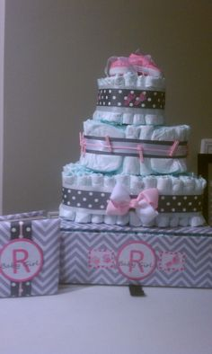 Square, pink, and gray chevron diaper cake, that I made for one of my friends baby shower....