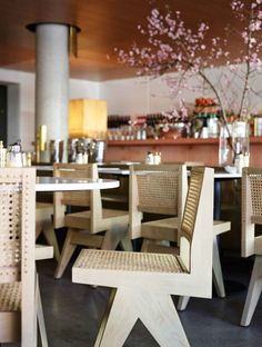 Simple Sophistication: Marble and timber surfaces, combined with raw concrete pillars and rattan dining chairs creates a stylish dining space at Bills in Bondi. #FieldNotes #inteior #design #restaurant #trends #Sydney #chairs #contemporary