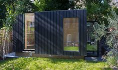 Charred cedar clads the exterior of this garden room that architect Neil Dusheiko designed as an office-cum-yoga studio for a north London residence