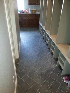 Removed Previous Dated Tile From Laundry And The Wood Flooring Mud Room Replaced With Slate Installed Herringbone Pattern Used 12 X 24 Tiles