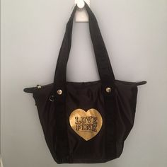 """VS PINK Black and Metallic Gold Heart Tote Victoria's Secret PINK - black nylon, slouchy tote. Huge gold metallic heart on front that says """"LOVE PINK"""". Great for school or the beach! Zip pocket on inside, and two phone pockets. Worn a few times as a book bag, only a tiny bit of wear on one strap. The straps are thick and go underneath the whole tote for extra reinforcement. PINK Victoria's Secret Bags Totes"""