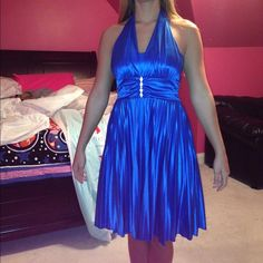 Blue prom, homecoming, formal dance dress Gorgeous royal blue formal dance dress. Halter around the neck. It's too big for me, so it's a little long on me. Has been worn once. Willing to negotiate :) Taboo Dresses Midi