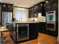 Custom #kitchen w/ double wall ovens, wine fridge & prep sink.