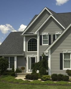 Light Grey House With Dark Grey Shutters And Dark Grey Garage Door Red Front Door Exterior