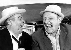 French comic actors Louis de Funès, and André Bourvil; their laughter is contagious