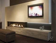 low profile fireplace with a corner aspect, built ins below/hearth, tv wall. Modern Fireplace, Fireplace Design, Living Room Interior, Living Room Decor, Tv Wand, Villa, Home And Family, New Homes, House Design