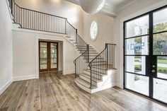 5201 Green Tree Rd Houston, TX 77056: Photo Elegantly designed metal front door with glass.  Grand foyer has gorgeous French Oak floors and staircase. The entry provides a view of the living and dining room.