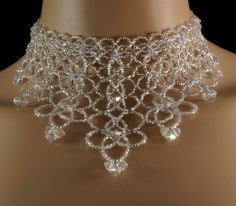 Swarovski crystal beaded bridal fringe choker. Swarovski crystal + Preciosa silver beaded fringe choker. Swarovski wedding statement choker  Sparkling silver Czech glass weaves an elaborate design with accents of AB Swarovski crystal. AB is an iridescent coating that enhances the crystals luminescence and sparkles in hues like a prism. The crystals dot along the length of the choker. As the intricate design splays across the chest, it culminates in graduated dazzling Swarovski crystal tips…