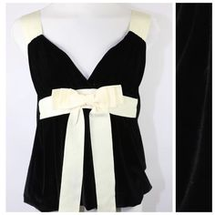 Alvin Valley Black Velvet Ivory Bow Top 12 44 Alvin Valley Black Velvet Top  Size 44/12   Retail $275  Beautiful top.  Black velvet body with ivory ribbon straps.  Love the bow on the front.  94% polyester, 6% spandex.  Lots of stretch to this top.  Perfect for the holidays!  Can be worn to a formal event with a cute skirt or dressed down with jeans.  Please check the measurements as this top runs small.  ‼️ PRICE FIRM UNLESS BUNDLED WITH OTHER ITEMS FROM MY CLOSET ‼️   Bust is approximately…