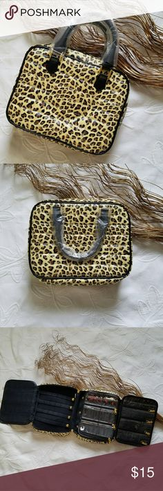 Leopard Print Portable Jewelry Holder Brand new  8x10 Multi compartment jewelry holder  One sleeve is removable  Zipper closure  Can also be used for nail art supplies or makeup Bags