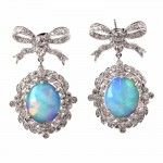 These exquisite estate diamond and opal drop pendant earrings are crafted in solid 18K white gold, weighing app: 9.9 grams and measuring approx: 30mm x 19mm.   With genuine round cut diamonds approx: 1.75cttw, H-I color, VS clarity in prong and bezel setting are 2 genuine opal cabochons in a prong setting, measuring approx: 13mm x 10mm.