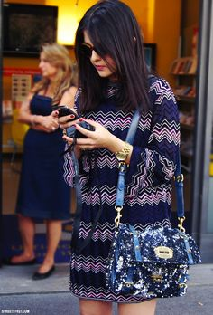 Love the glittery bag with the zigzag dress. So unexpected.