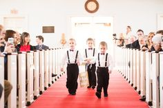 Ring bearers carry sign down the aisle during catholic ceremony. Stephanie and Kyle's St. Louis winter wedding at the Palladium | St. Louis Wedding Photographer — Erin Stubblefield Weddings and Portraiture | Documentary Photojournalist and St. Louis Wedding Photographer