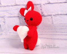 Lovely amigurumi crochet bunny perfect soft cuddly toy for your boyfriend or girlfriend on Valentines Day. Made by hand with love.  Red Love Bunny with heart will be a wonderful gift for the boyfriend or girlfriend on Valentines Day.  - Color: as the photo. - Size: about 5,5 inches (14 cm) - Material: High quality baby yarn 100% Polyester eyes embroidered  Amigurumi plush bunny is ready to ship.  But if you have the desire to buy a bunny with a different color, I am always in touch and open…