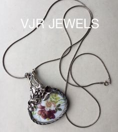VJR JEWELS necklace , I created the pendant. I framed this porcelan treasure in the silver frame and saved them from the dump. € 125,-