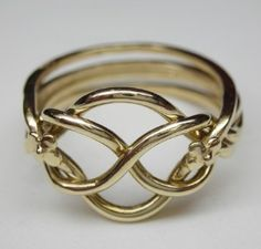 CELTIC KNOT RING. i so wanna have this but in white gold. this is the real origin why it's called tying the knot. LOOVE IT!