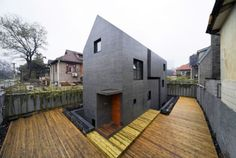 Concrete Slit House is a contemporary concrete residence. The structure and roof of the slit house are casted and fair-face finished entirely from concrete. The 270 square meters residence, in Nanjing, Jiangsu Province, China, is designed with various levels on the inside, creating rooms with ceiling heights extending one and a half levels and the reception/living area at two levels high, along with the slit (opening) in the concrete shell of the house.