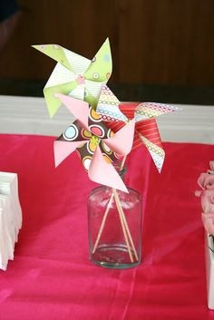 Tutorial on how to make pinwheels for a baby shower - use as centerpiece or stick in cupcakes.