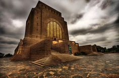 The Voortrekker Monument is a monument in the city of Pretoria, South Africa. The massive granite structure, built to honour the Voortrekkers who left the Cape Colony between 1835 and was designed by the architect Gerard Moerdijk who had the idea to Cape Colony, Soli Deo Gloria, Namibia, African History, African Art, Africa Travel, Countries Of The World, Places To See, South Africa