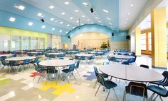 A great design for an elementary cafeteria with the bright colors keeping the mode happy and joyful for the kids.