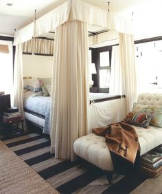 canopied bed + chaise longue + layered rugs