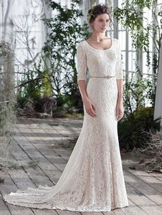 Maggie Sottero - Fairchild Sample Gown from Adina's Bridal (www.adinasbridal.com). I love the lace and the elbow length sleeves. So beautiful!!!