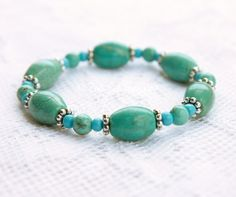 Turquoise and Tibetan Silver Stack Stretch Bead Bracelet. $12.00, via Etsy.