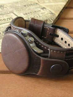 Watch strap of brown genuine leather with a protective cover on the button. Sewing Leather, Leather Craft, Mens Watches Leather, Watches For Men, Leather Projects, Leather Watch Bands, Leather Accessories, Leather Working, Watch Straps