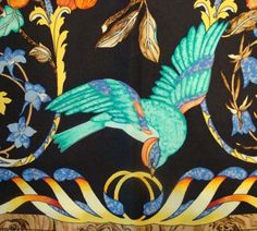 I love this one...birds and flowers in jewel colours. the yellow bordered scarf is probably my favourite of them all. This is a close-up of Hermes Pierres d'Orient et d'Occident silk scarf by Zoe Pauwels.