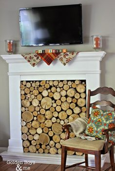 DIY faux fireplace with stacked wood logs with fall decor-www.goldenboysandme.com