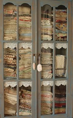 Fabric stored in a lovely hutch.  At one point, I put all my clothes in bins in the closet so I could use my chest of drawers for fabric storage.  Now my batik collection has pride of place in my china cupboard, along side my Moda designer collection, and that is just the beginning.....