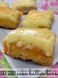 OOEY GOOEY Cake Bar Recipe! These are also called Chess Bars and are made with yellow cake mix, cream cheese, and powdered sugar.