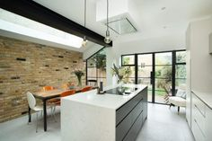 For this Camberwell property we carried out a side return extension with a large skylight and glass valley, which provide plenty of natural light into the new and existing areas . Kitchen Extension Victorian Terrace, Kitchen Extension Terraced House, Kitchen Extension Side Return, Victorian Terrace Interior, Kitchen Diner Extension, House Extension Design, Victorian Kitchen, Extension Ideas, Home Decor Kitchen