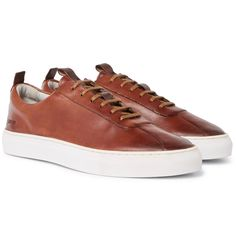 Inspired by '70s tennis shoes, <a href='http://www.mrporter.com/mens/Designers/Grenson'>Grenson</a>'s sneakers have a neat streamlined profile that works with sweatpants and tailoring alike. This handmade pair has leather uppers that are expertly painted in tonal shades of brown for a burnished appearance, and thick rubber soles. You'll notice they're stamped at the heel with the words 'The Good Shoe', an apt adage...