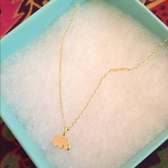Lf Gold Elephant Necklace Gold elephant necklace from LF! Super adorable for the summer. From the winter collection, but the necklace is back full price in stores now. Can be adjusted 3 different lengths. New with tags!! Does not come in box shown, but it will come in a box :) LF Jewelry Necklaces
