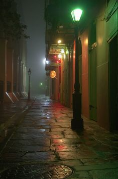 Pirates Alley, from a corner of Cabildo Alley toward Chartres Street, with a south-west side of Saint Louis Cathedral on the left in French Quarter at early morning in mist. New Orleans, Louisiana, February 2006 Photo by Alexey Sergeev Nova Orleans, New Orleans Louisiana, Places To Travel, Places To See, St Louis Cathedral, Neon Licht, Photographie Portrait Inspiration, New Orleans Travel, Beautiful Places