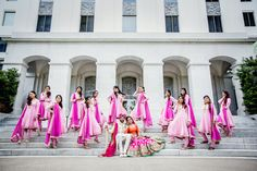 Sikh Punjabi bride and groom with bridesmaids in pink suits