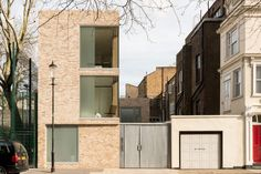 This Modern Brick Home by Feilden Clegg Bradley Studios is a beautiful structure composed of a minimal approach inside and out.