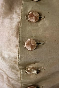 Detail buttons and stitching, Riding waistcoat, ca. 1775, British (probably), silk, linen. Met Museum