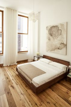 Reclaimed New Face Oak flooring sourced from barns throughout the mid-Atlantic region, in a bedroom designed by SMVRK Architects.
