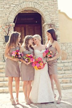 Neutral bridesmaids with bright bouquets