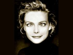 I love this photo of Michelle Pfeiffer, caught in a playful moment of time!