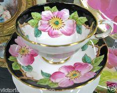 Apple blossom on black cup