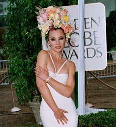 Pin for Later: 43 Golden Globes Hair and Makeup Looks That Weren't So Pretty Fran Drescher, 1996 Fran Drescher got a little too Carmen Miranda at the Globes back in '96.