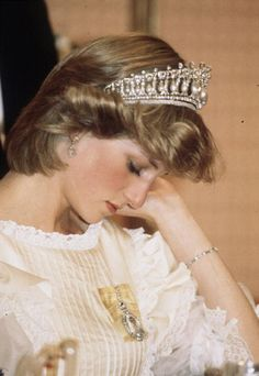 Princess Diana of Wales, looking down and perhaps resting for a bit, during a visit in New Zealand in April 1983.