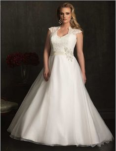 "<a href=""http://www.allurebridals.com/products/w324"" target=""_blank"">This showstopper</a> from Allure Bridals Women Collection"