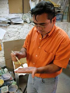 Gogo González demonstrates painting techniques in his father's Mexico workshop. Gorky González ceramics have long been known for fusing traditional techniques with creative flair. #ceramics #pottery