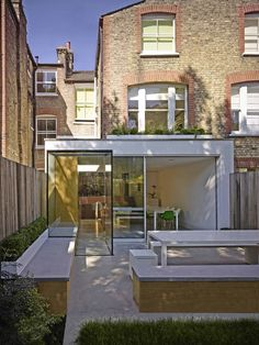 Interesting Glass extension - like the plants on the roof